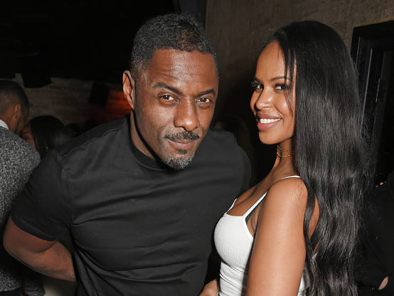 Still Going Strong: Idris Elba Spotted With His Copious Curve Having Bae At His Christmas Party