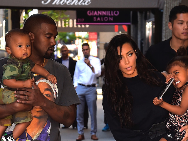 Kanye Goes Full Denim Daddy Duty On New Christmas Card Pic With Kim K, North, And Saint
