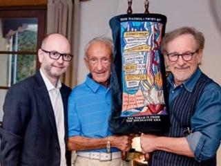 Survivor Ed Mosberg of the film DESTINATION UNKNOWN Donates Torah to Steven Spielberg