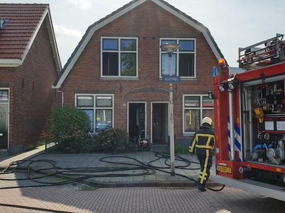 Slaapkamer van woning in Enschede loopt schade op door brand
