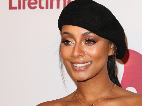 "Pure Comedy: Keri Hilson Celebrates A Year Of ""Coupledom"" With A Fan"