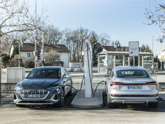 Audi investing ~€100M in charging infrastructure at German sites; 10% of parking spaces by mid-2022