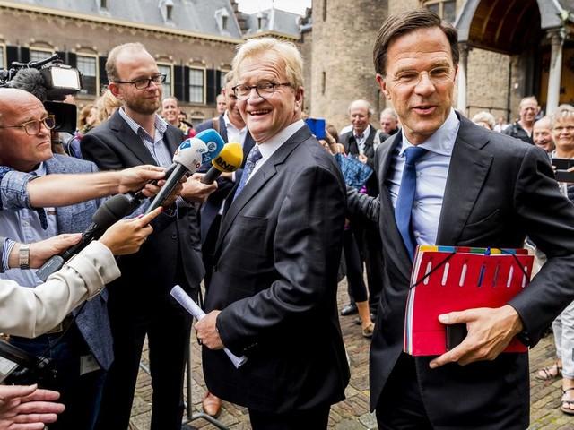Rutte en werkgeversvoorman De Boer hebben boter op het hoofd in loondiscussie