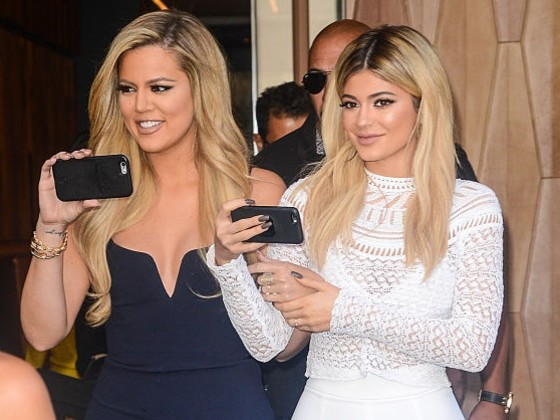 Pregnant Pop Out: Knocked Up Sisters Kylie And Khloe Hide Their Bumps In All Black While Hawking Lip Kits [Video]