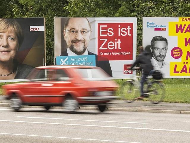 Tyska väljare trängs med maratonlöpare