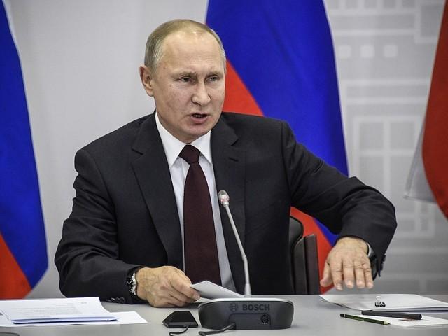 Putin kan runda globalt system med kryptovaluta