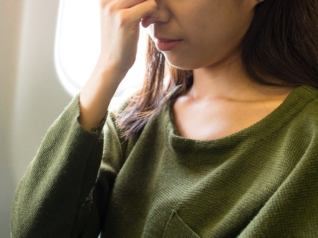 What to do if you get sick while traveling to another country