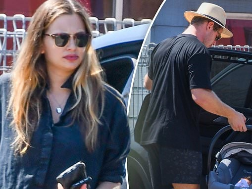 Tom Burgess and hisfiancée Tahlia Giumelli step out with theirnewborn daughter
