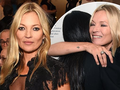 Kate Moss pulls off a chic display in a sheer black blouse as she embraces Demi Moore