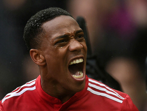 Supersub Martial stars as United down Spurs