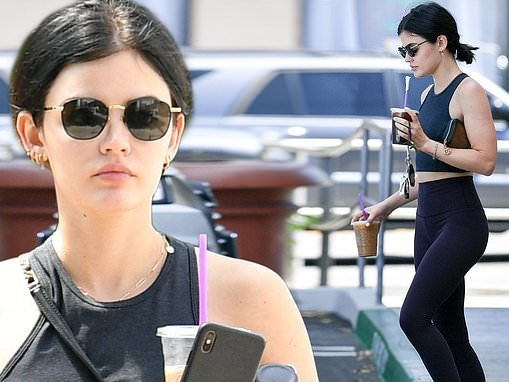 Lucy Hale flaunts her fit figure in black leggings and matching sports bra during a coffee run