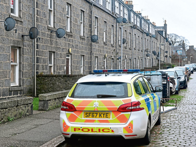 Manhunt after Aberdeen flat 'disturbance' leaves two seriously hurt