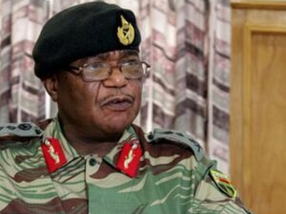 Military outside Zimbabwe capital after army chief's threat