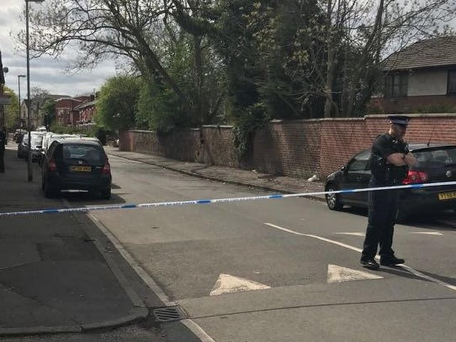 Police tape surrounds street in Longsight following reports of 'road rage' and 'stabbing'