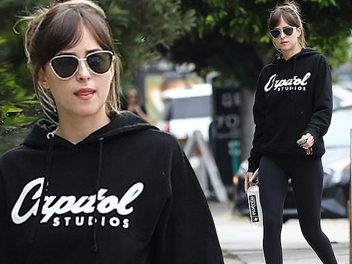 Dakota Johnson shows off her lithe figure in hoodie and leggings as she heads to workout in LA