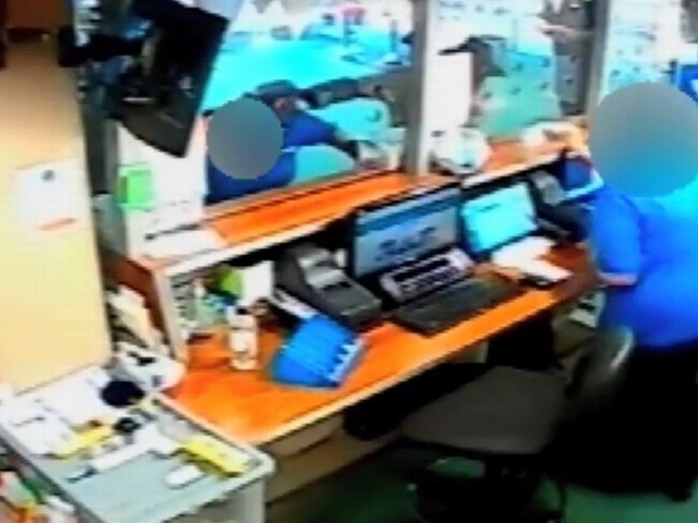 Armed robber holds weapon to staff member's head during raid at bookmakers