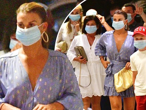 Coleen Rooney is leggy in a chic blue frilled dress as she heads out for dinner in Barbados