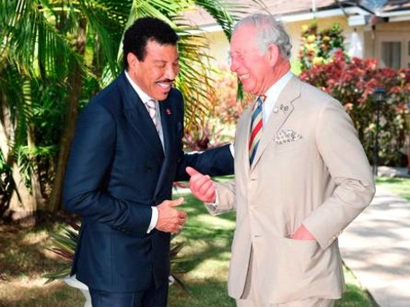 Hello! Prince Charles and Lionel Richie share a joke in Barbados