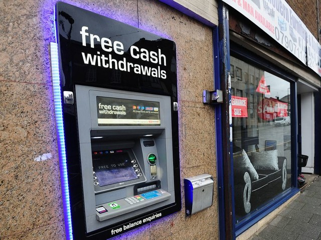 Man left with 'potentially life-changing injuries' after being mugged at a cash machine