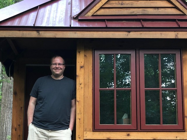 Moving into a tiny house helped one 35-year-old increase his income and save $100,000 in 5 years — here's how he did it