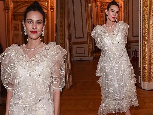 Alexa Chung looks effortlessly elegant in a feminine white dress