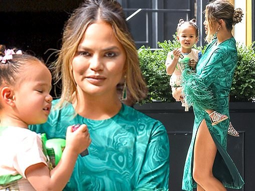 Chrissy Teigen heads to the Tonight Show Starring Jimmy Fallon with daughter Luna in her arms