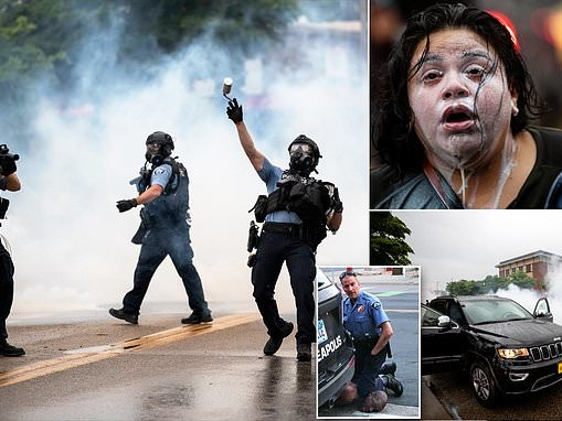Police in riot gear spray tear gas and fire rubber bullets at protest over George Floyd's death