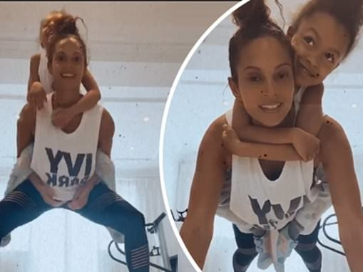 Alesha Dixon shows off her muscles as she works out with daughter Azura, six