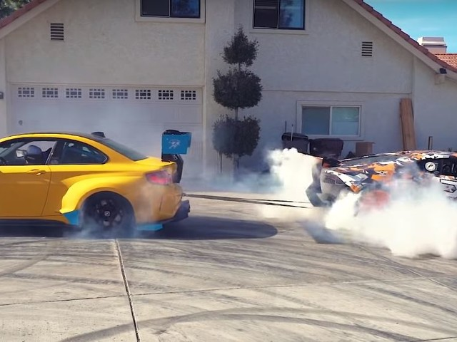 Video: BMW M2 and Lamborghini Huracan Tangle in Tug of War