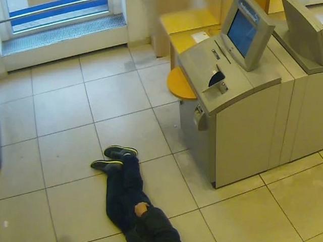 Germans fined over pensioner left to die in bank branch