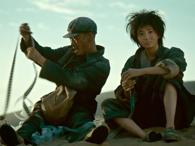 'One Second' Review: Zhang Yimou's Lovely, Poignantly Imperfect Tribute to the Delight and the Delusion of Cinema
