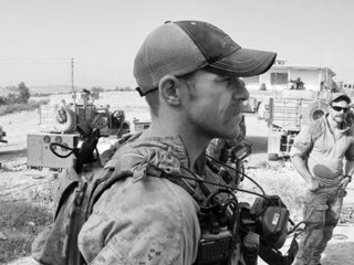 Navy SEAL accused of war crimes allegedly threatened to kill teammates if they talked, court documents show
