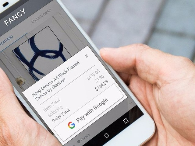 Google launched a new payment system that lets people buy stuff online with super-fast checkout (GOOG)