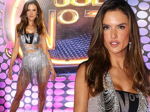 Alessandra Ambrosio wows in silver fringed dress as she returns to Brazil for carnival