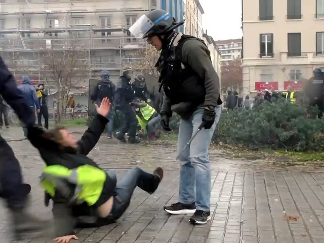 French police drag female Yellow Vest protester in Lyon