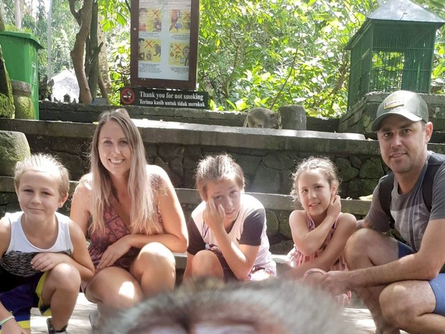 Brazen monkey takes selfie with stunned family - then gives them the finger