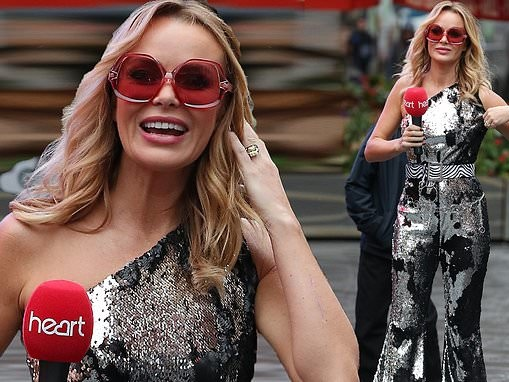 Amanda Holden looks radiant as she dons 70s-inspired silver jumpsuit at Globa's charity event