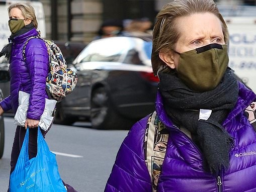 Cynthia Nixon stands out from the crowd as she shops in purple quilted jacket in NYC