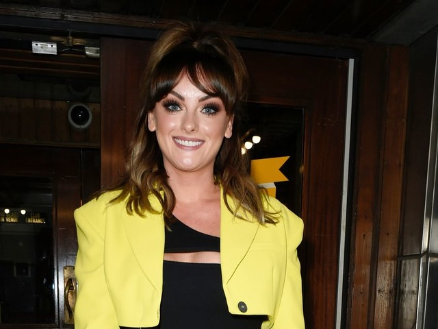 Katie McGlynn shows off new look in bold neon outfit on night out in Manchester