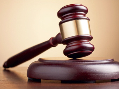 Company director claims trial to 43 money-laundering, 75 false claim charges