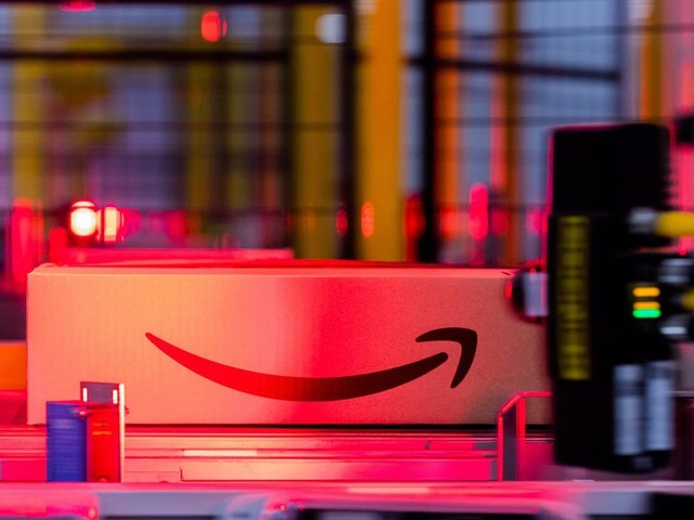 Amazon, faced with criticism over warehouse employee injuries, tests new tech to make moving packages safer (AMZN)