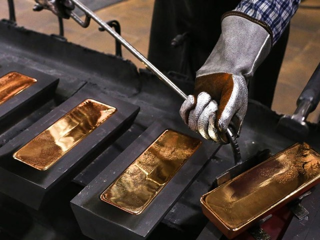 Metals and currency markets face uncertainty due to a recent rise in gold. Here's what experts are saying about this economic phenomenon.