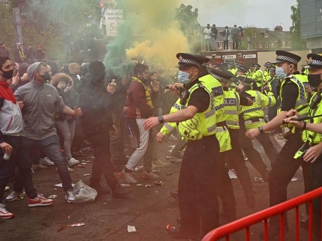 Man Utd vs Liverpool match postponed after fans storm Old Trafford pitch