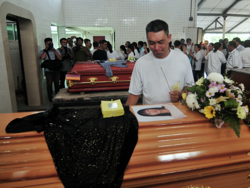 Swee Bok inconsolable as family laid to rest