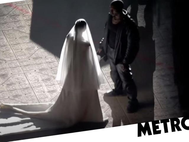 Kim Kardashian emerges in wedding dress at estranged husband Kanye West's Donda listening party