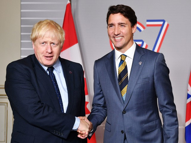 Brexit: UK and Canada agree 'rollover' deal to continue trading on existing EU terms