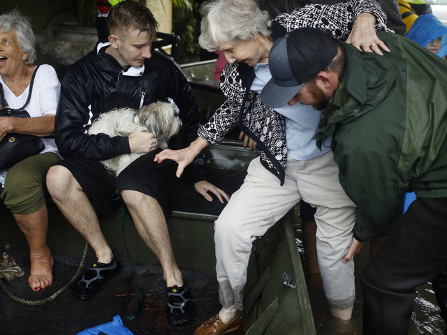 Houston Flooding Prompts Acts Of Heroism And Bravery Among Texas Citizens