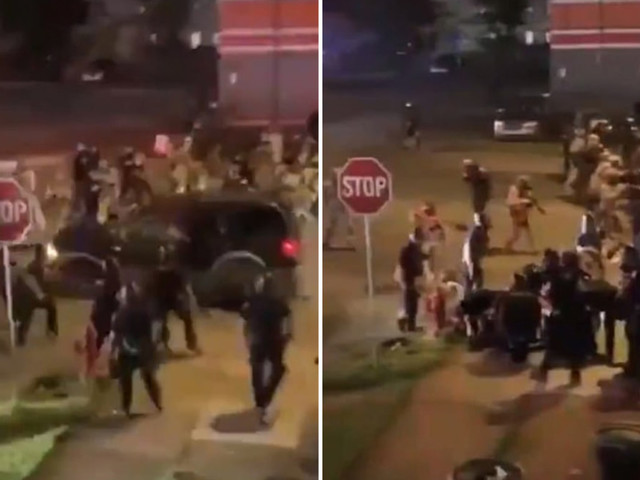 Shocking moment car ploughs through group of police tackling protesters leaving two people injured in Buffalo