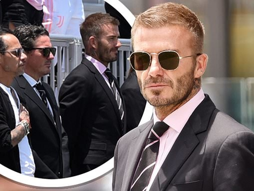 David Beckham cuts a suave figure in a suit and tie as he supports his football club Inter Miami
