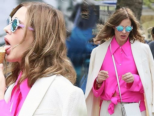 Trinny Woodall, 57, looks stylish in bright pink shirt and white coat as she licks ice cream
